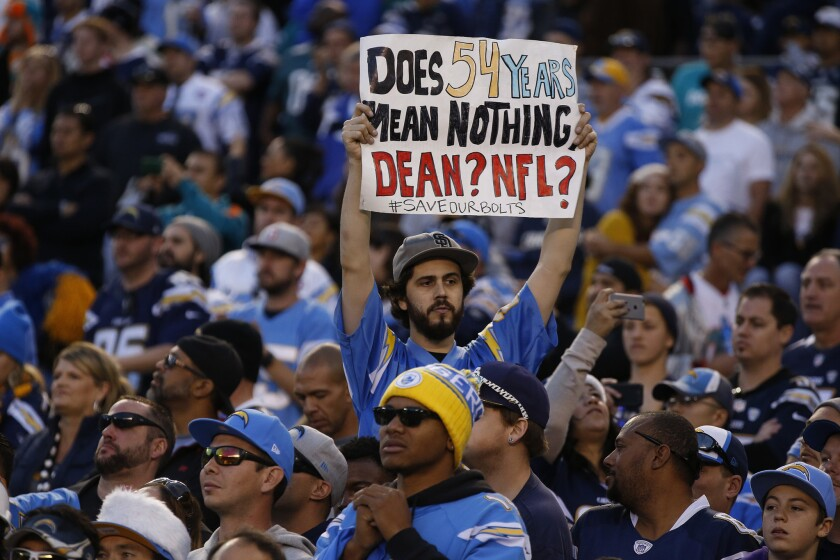 A fan shares his feelings from the stands as the Chargers play the Miami Dolphins in what could be the team's final game in San Diego, on Dec. 20.