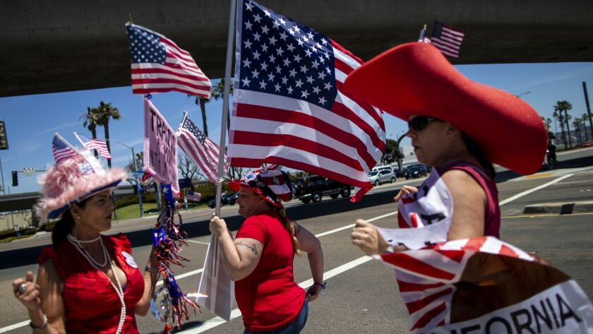 SAN DIEGO, CALIF. - MAY 05: Supporters of Republican gubernatorial candidate Travis Allen hold flags