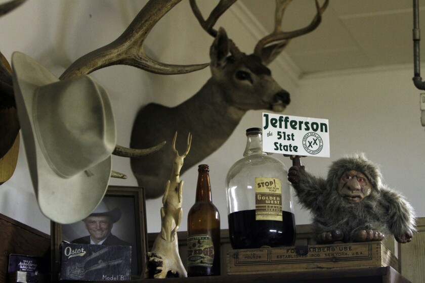 """A sign proclaiming Jefferson """"the 51st State"""" is seen at Yreka's Palace Barber Shop in Yreka, Calif."""