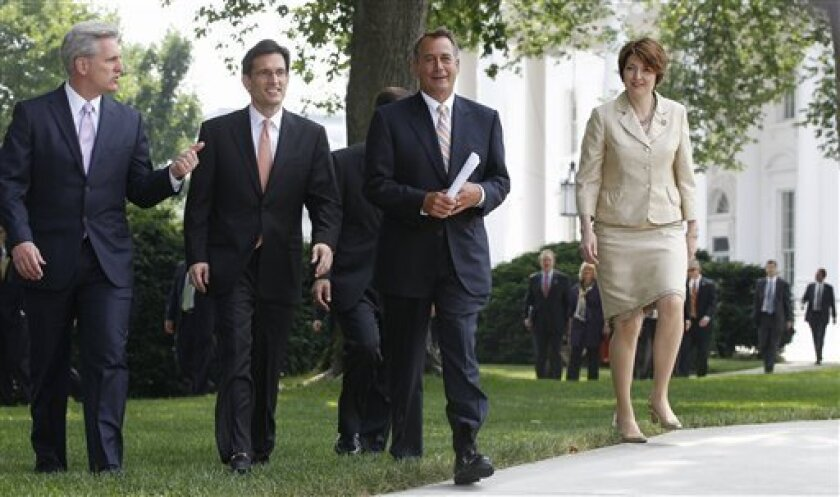 House Speaker John Boehner of Ohio, second from right, accompanied by, from left: House Majority Whip Kevin McCarthy of Calif.; House Majority Leader Eric Cantor of Va.; and Rep. Cathy McMorris Rodgers, R-Wash., leave the White House in Washington, Wednesday, June 1, 2011, after their meeting with President Barack Obama regarding the debt ceiling. (AP Photo/Charles Dharapak)