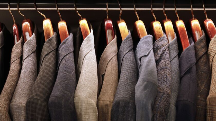 BEVERLY HILLS, CA -- DECEMBER 04, 2018: Men's jackets line a rack at Carroll & Co. The 70-year-old c