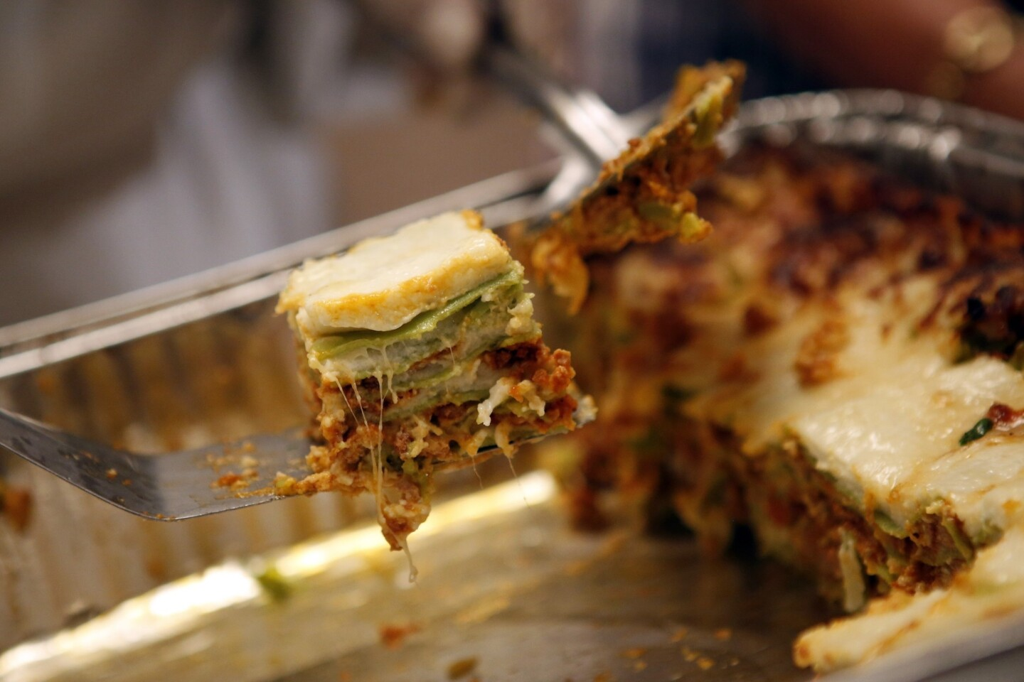 Lasagna verde with meat ragu and spinach, served by Gino Elizabeth Angelini.