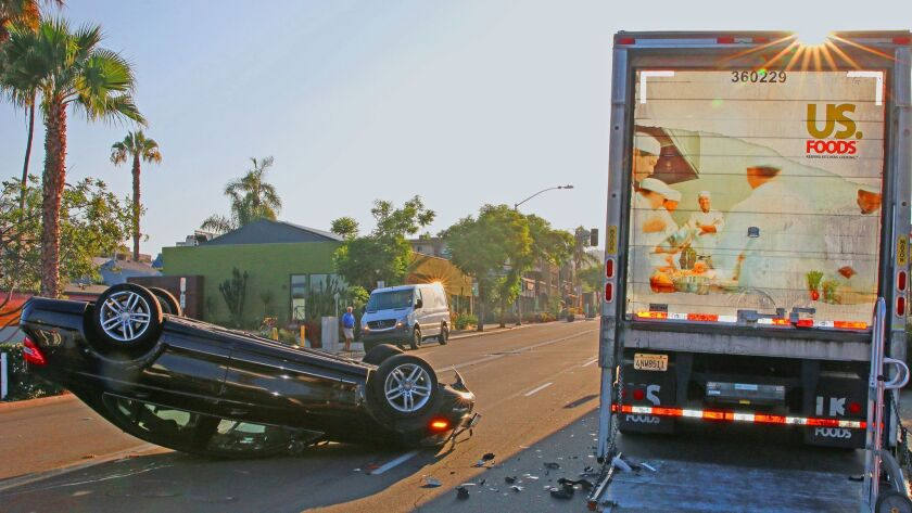 A black Mercedes heading east on the 600 block of Pearl Street flipped over after it struck the back of a parked, restaurant-supply truck shortly after 7 a.m. Monday, Aug. 6.