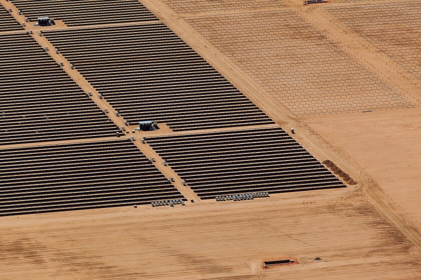 Panels at a solar farm in the Mojave Desert. Valley fever is caused by spores of a fungus that lives in the soils common to California's Central Valley, and building solar power plants can require scraping thousands of acres of land. There has been an outbreak of valley fever in San Luis Obispo County.