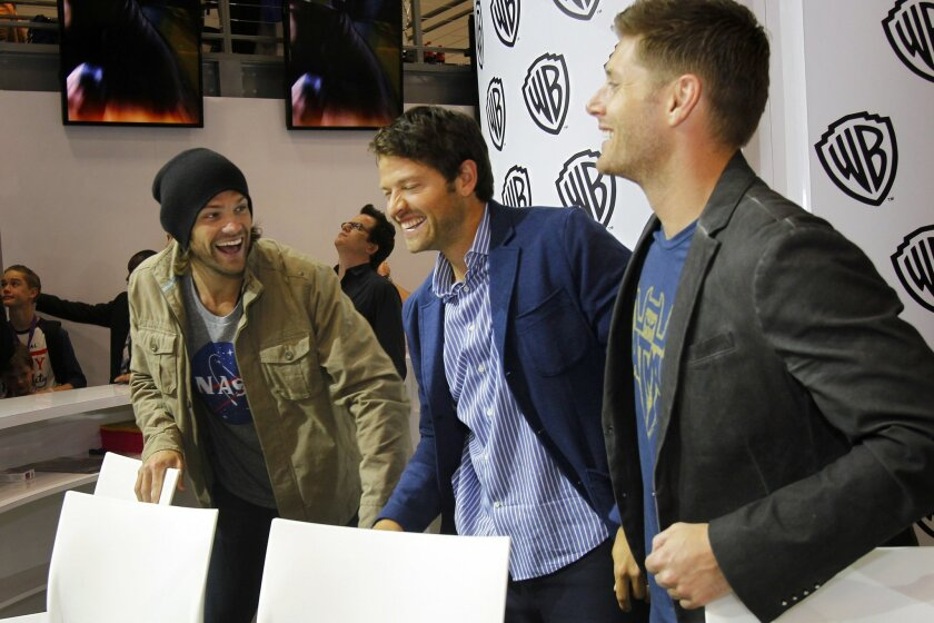 "Actors Jared Padalecki, Misha Collins and Jensen Ackles of the television show ""Supernatural"" signed autographs at Comic-Con."