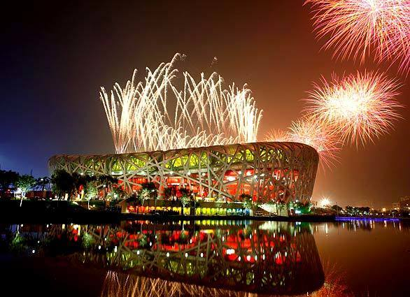 Fireworks light the National Stadium during Olympics opening ceremony Friday night in Beijing. More... • Blog: Ticket to Beijing • ... more Olympic Photo Galleries