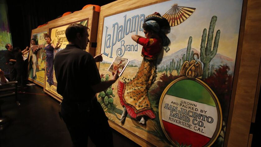 "Cast member Emily Ricketts is set in place for one of the Orange Crates tableaux ""La Paloma"" during"