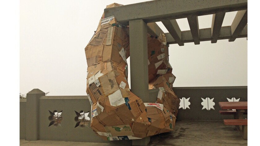 """The side view of Michael Parker's """"Ides,"""" a sculpture made of cardboard installed in San Pedro."""