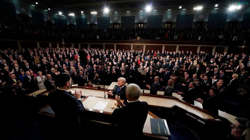 President Donald Trump arrives to deliver his State of the Union address to a joint session of U.S.