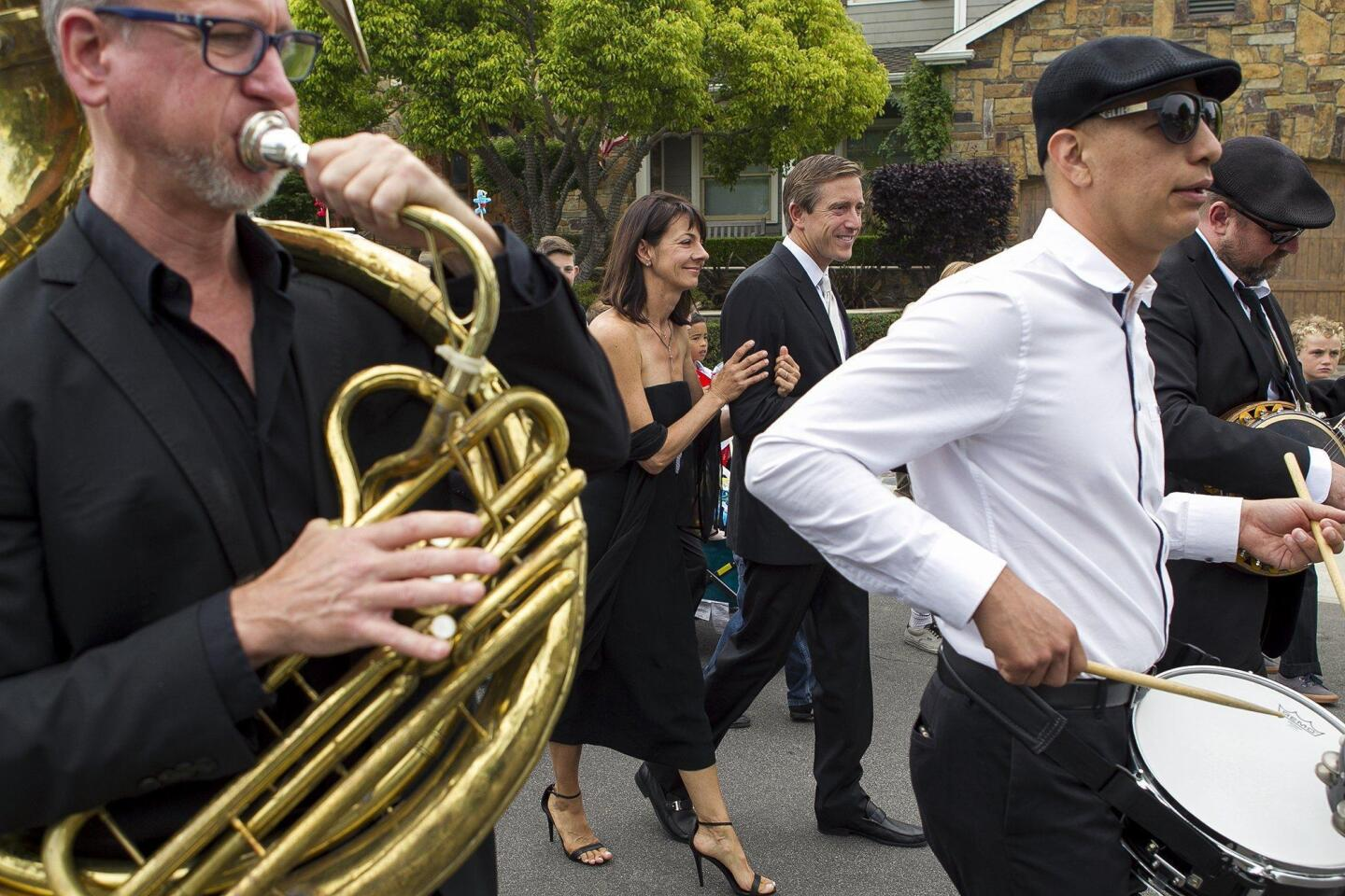 Bernadette and Murphy McCann, the parents of Brock McCann, a Newport Beach 8-year-old who was struck and killed by a trash truck in May, lead a New Orleans-style parade in memory of their son on Saturday.