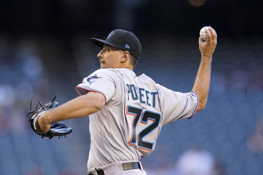Miami Marlins starting pitcher Cody Poteet throws against the Arizona Diamondbacks during the first inning of a baseball game Wednesday, May 12, 2021, in Phoenix. (AP Photo/Ross D. Franklin)