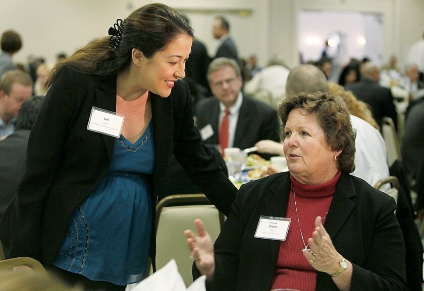 Lani Lutar (left) then-leader of the San Diego County Taxpayers Association, talks with Cheryl Cox, mayor of Chula Vista, at an event in 2010. During her years with the taxpayer group, Lutar won accolades for well-researched analysis and reports on local tax and public pension issues.
