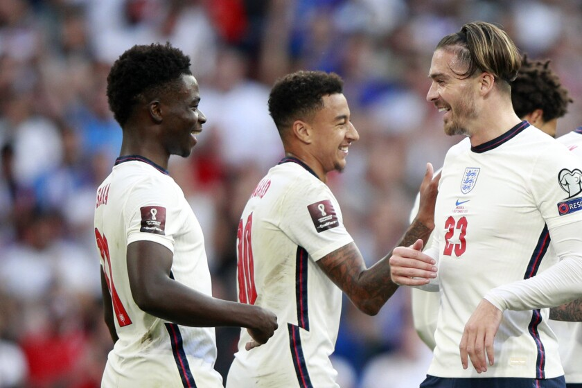 England's Bukayo Saka, left, reacts after scoring his side's fourth goal during the World Cup 2022 group I qualifying soccer match between England and Andorra at Wembley stadium in London, Sunday, Sept. 5, 2021. (AP Photo/Ian Walton)
