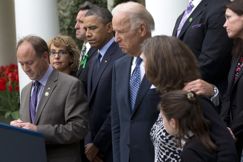 Mark Barden, left, who lost his son Daniel in the Newtown, Conn., school shooting, speaks at the White House.