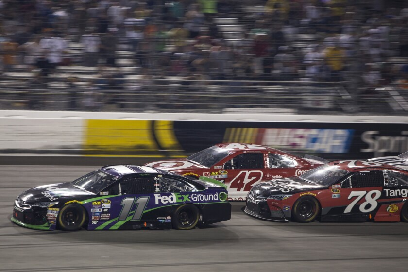 Denny Hamlin leads Kyle Larson and Martin Truex Jr. during the NASCAR Sprint Cup race at Richmond International Raceway on Sept. 10.