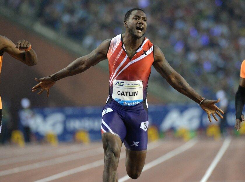 Justin Gatlin of the U.S. wins the men's 100m at the Diamond League Memorial Van Damme athletics event, at Brussels' King Baudouin stadium, on Friday, Sept. 5, 2014. (AP Photo/Geert Vanden Wijngaert)