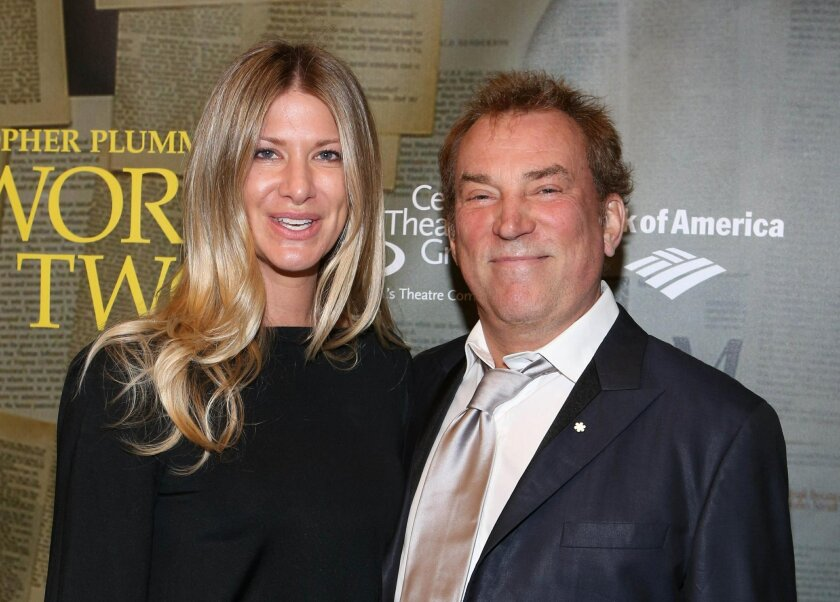 """FILE - In this Jan. 22, 2014 file photo, director Des McAnuff and his wife, Bryna, pose during arrivals for the opening-night performance of """"A Word or Two"""" starring Christopher Plummer at the Center Theatre Group/Ahmanson Theatre in Los Angeles."""