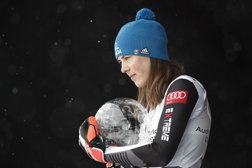 Slovakia's Petra Vlhova holds the trophy of the alpine ski, women's World Cup overall title, in Lenzerheide, Switzerland, Sunday, March 21, 2021. (AP Photo/Gabriele Facciotti)