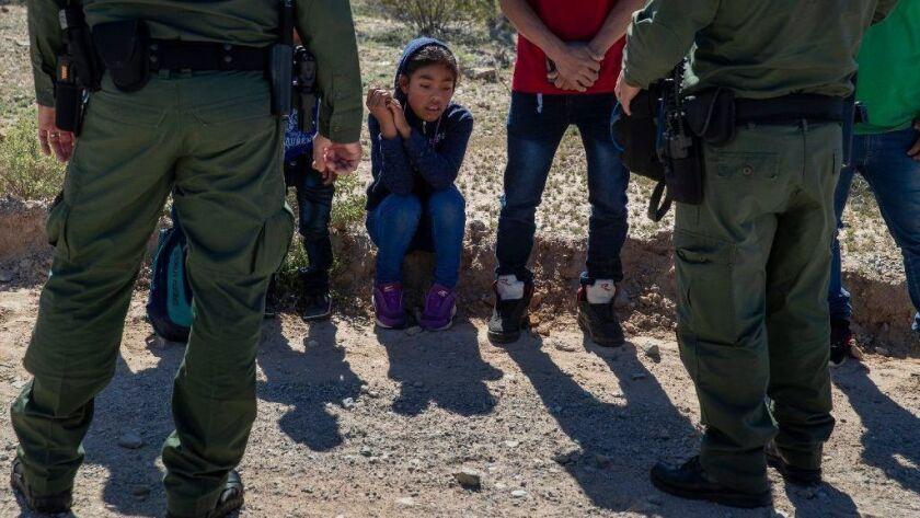 Border Patrol agents detain Guatemalan migrants in Arizona this week.