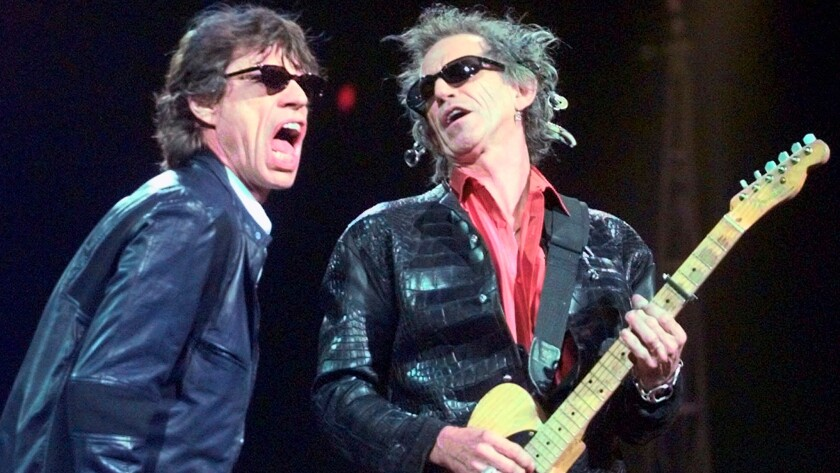 The Rolling Stones will be a featured act at the Desert Trip festival. Mick Jagger, left, and Keith Richards, are shown here during the band's No Security Tour in Boston in 1999.
