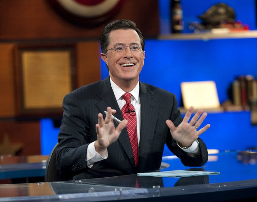 """In this Sept. 8, 2010 photo released by Comedy Central, Stephen Colbert appears during """"The Colbert Report,"""" in New York."""
