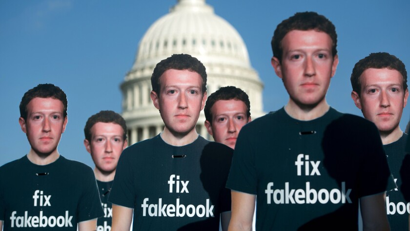 One hundred cardboard cutouts of Facebook founder and CEO Mark Zuckerberg stand outside the U.S. Capitol in April.