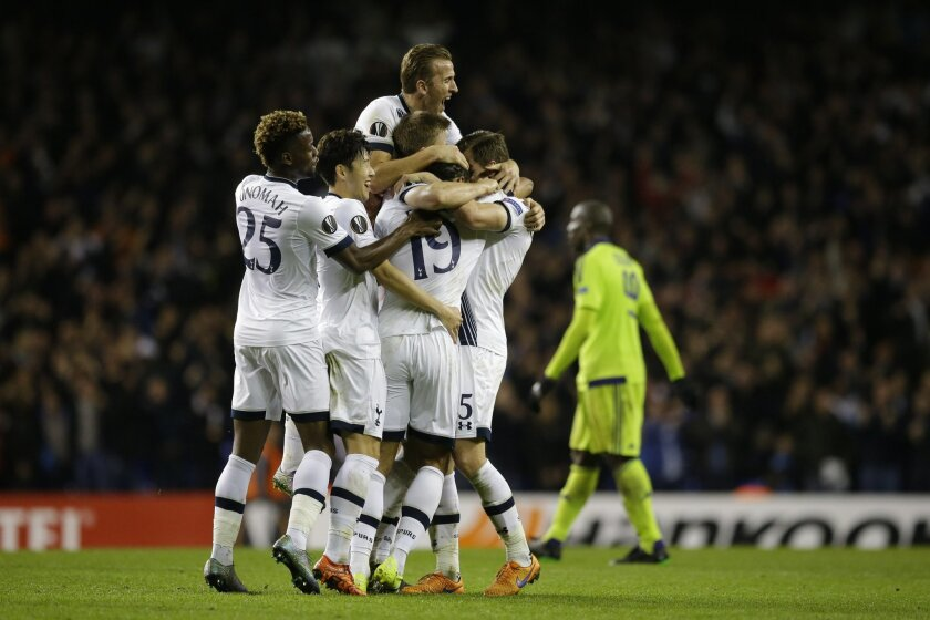 Tottenham's Mousa Dembele, 19 center, celebrates scoring his side's second goal with, from left, Joshua Onomah, Son Heung-min, Harry Kane and Jan Vertonghen during the Europa League Group J soccer match between Tottenham Hotspur and Anderlecht at White Hart Lane stadium, in London, Thursday, Nov. 5