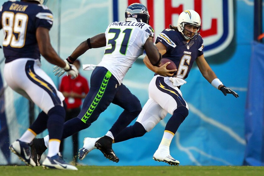 Chargers Charlie Whitehurst scrambles against the Seahawks.