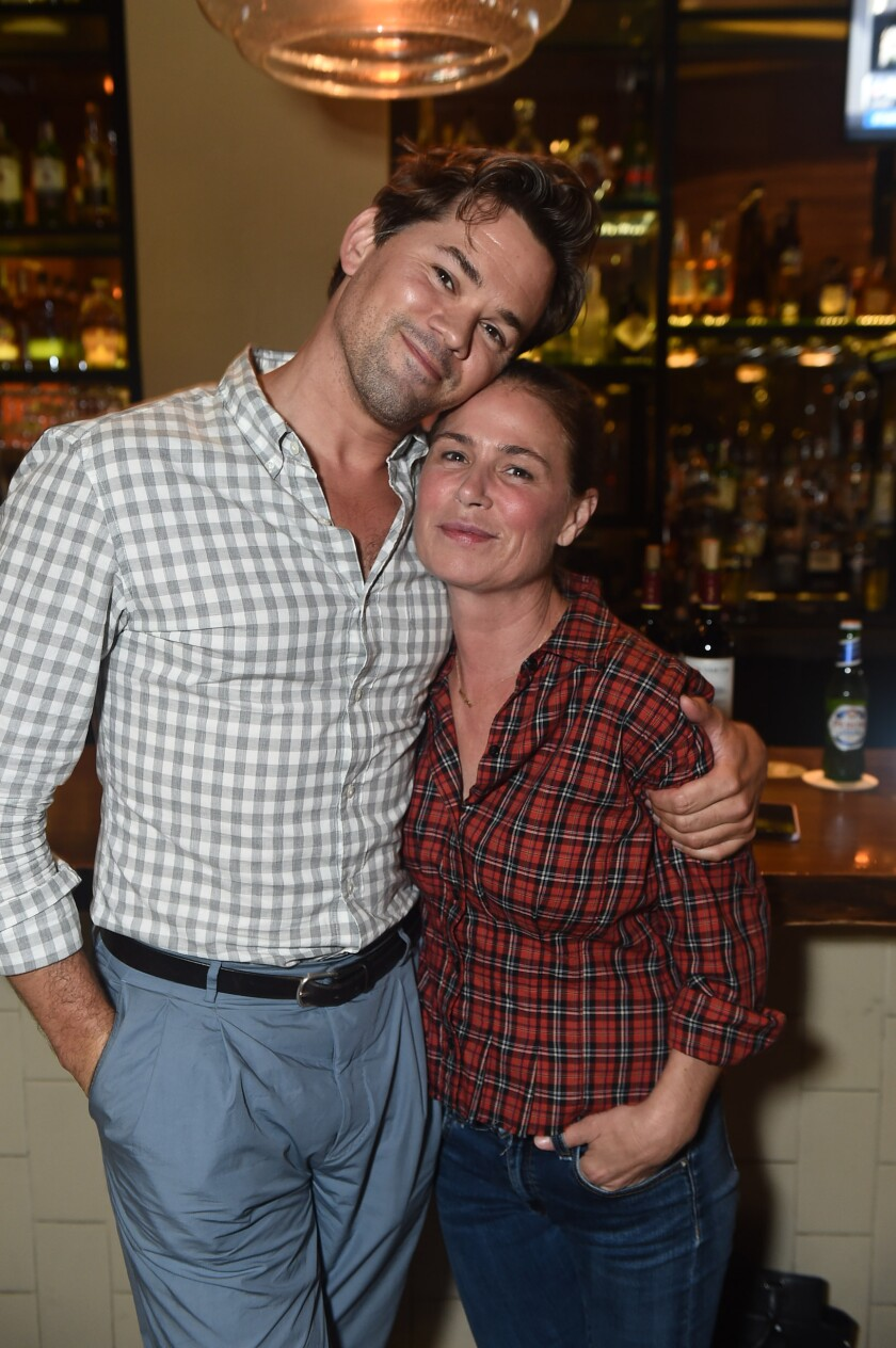 "Andrew Rannells and Maura Tierney at the opening-night gathering for ""Skintight."""