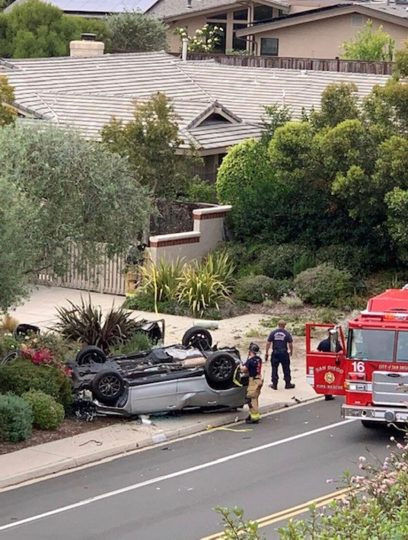 A car flipped on Cardeno Drive, knocking over a San Diego Gas & Electric utility box and causing a power outage in the area.