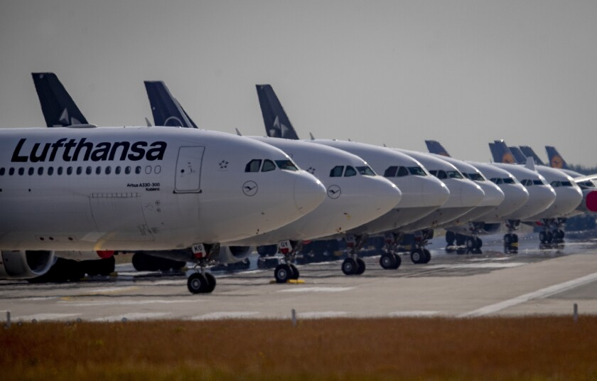 Lufthansa aircrafts are parked on a runway at the airport in Frankfurt, Germany, Wednesday, June 3, 2020. Due to the coronavirus the airline had to cancel 95 percent of its flights recently. (AP Photo/Michael Probst)