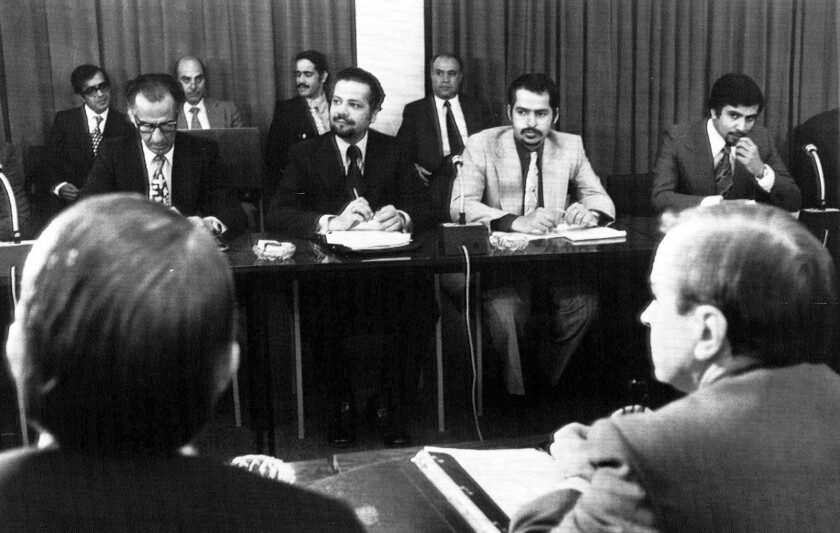 FILE - In this Oct. 8, 1973, file photo, oil ministers of six Persian Gulf countries and representatives of western nations meet in Vienna, Austria, to negotiate price boosts sought by oil producers. Facing each other, are from left to right, Dr. Jamshid Amouzegar, then Iran Finance Minister, then Saudi Oil Minister Ahmed Zaki Yanani. Yamani, a long-serving oil minister in Saudi Arabia who led the kingdom through the 1973 oil crisis, the nationalization its state energy company and later found himself kidnapped by the assassin Carlos the Jackal, died Tuesday, Feb. 23, 2021, in London. He was 90. (AP Photo, File)
