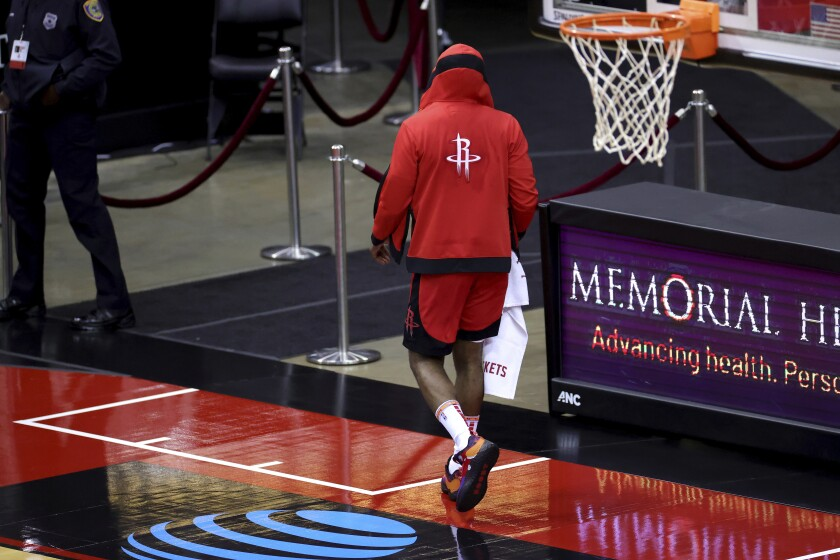 Houston Rockets' James Harden leaves the court following a loss to the Los Angeles Lakers in an NBA basketball game Sunday, Jan. 10, 2021, in Houston. (Carmen Mandato/Pool Photo via AP)