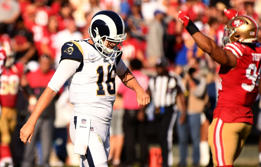 Ramas quarterback Jared Goff walks off the field against the 49ers.