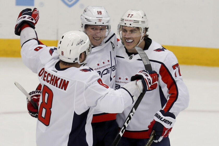 Washington Capitals' T.J. Oshie, right, celebrates with teammates Alex Ovechkin (8) and Nicklas Backstrom (19) after scoring against the Pittsburgh Penguins during the third period of an NHL hockey game, Saturday, March 7, 2020, in Pittsburgh. The Capitals won 5-2. (AP Photo/Keith Srakocic)