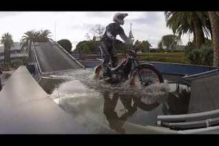 L. A. Auto Show: Trials bike on Land Rover obstacle course
