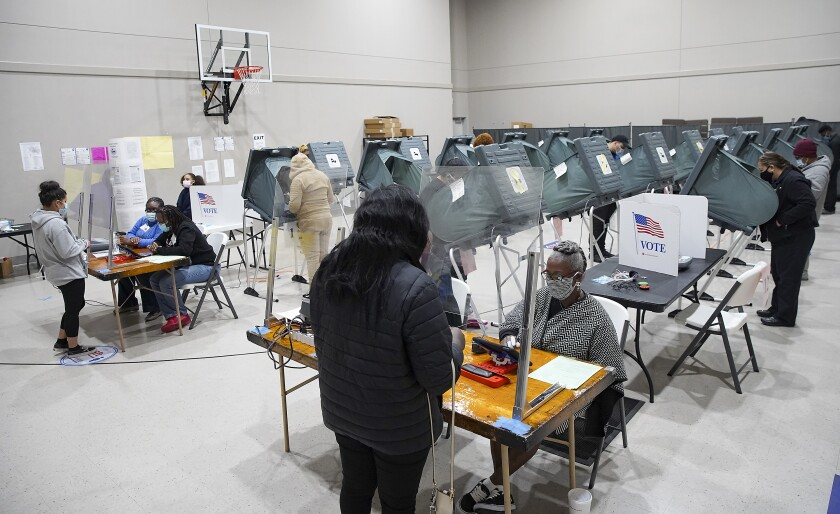 Voters cast their ballots for the general election at Victory Houston polling station in Houston, on Friday, Oct. 30, 2020. The location was one of the Harris County's 24-hour locations. (Elizabeth Conley/Houston Chronicle via AP)