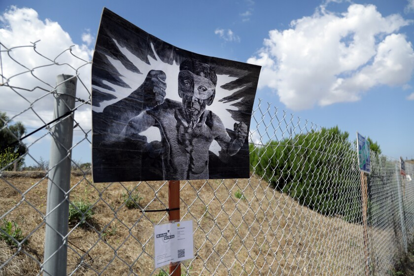 "Abel Alejandre's ""Street Fighter"" on display on a Signal Hill fence. The gallery Durden and Ray has enlisted 100 artists to place their work in public around Los Angeles County."