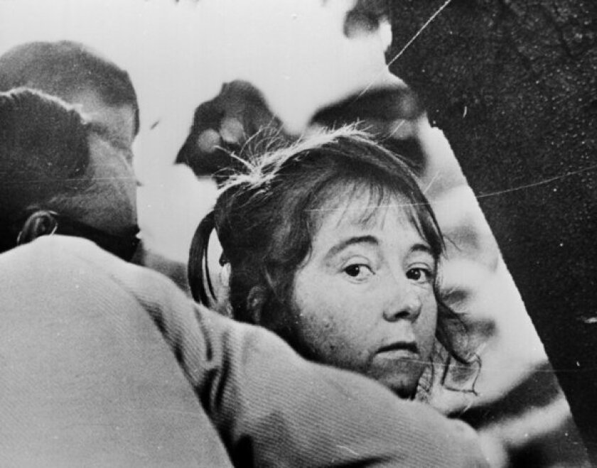 "Lynette ""Squeaky"" Fromme is led away after her failed 1975 assassination attempt on President Ford."