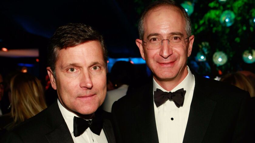NBCUniversal Chief Executive Steve Burke, left, and his boss, Comcast Chairman and Chief Executive Brian Roberts, following the Golden Globes ceremony in Beverly Hills in 2013.