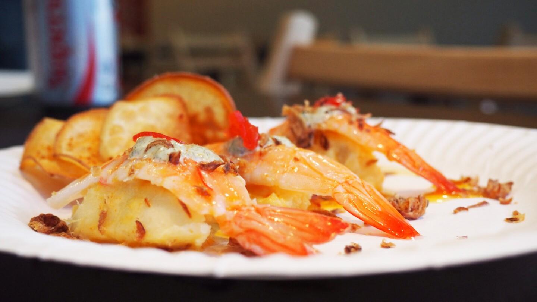 An order of shrimp causa includes three pieces of amaebi shrimp, Peruvian potato salad, shiso pesto, leche de tigre and scallions.