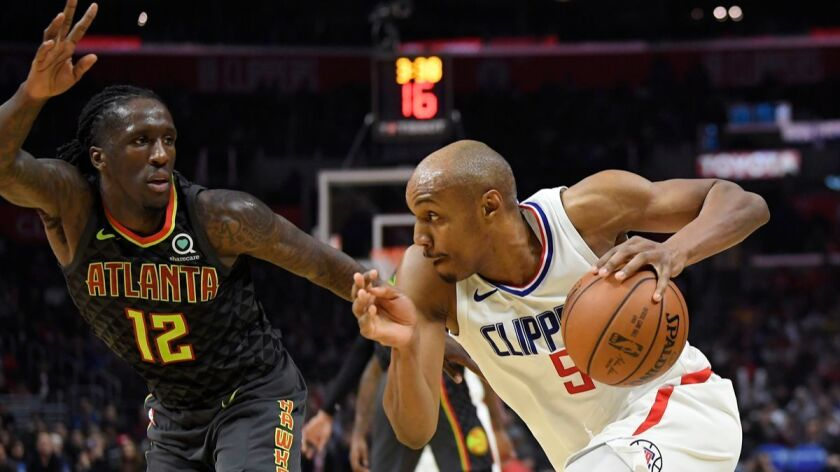 Clippers guard C.J. Williams, driving by Hawks forward Taurean Prince, hit the game-winning three-pointer Monday against Atlanta.