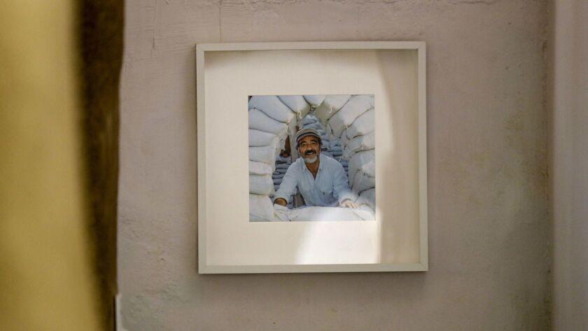 CalEarth founder Nader Khalili on a wall inside Earth One.