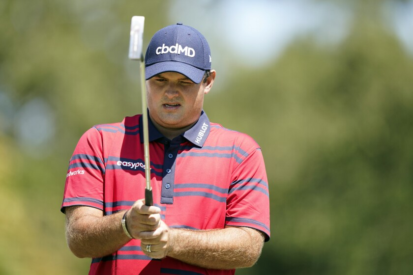 Patrick Reed lines up his putt on the second green during the third round of the Tour Championship golf tournament Saturday, Sept. 4, 2021, at East Lake Golf Club in Atlanta. (AP Photo/Brynn Anderson)