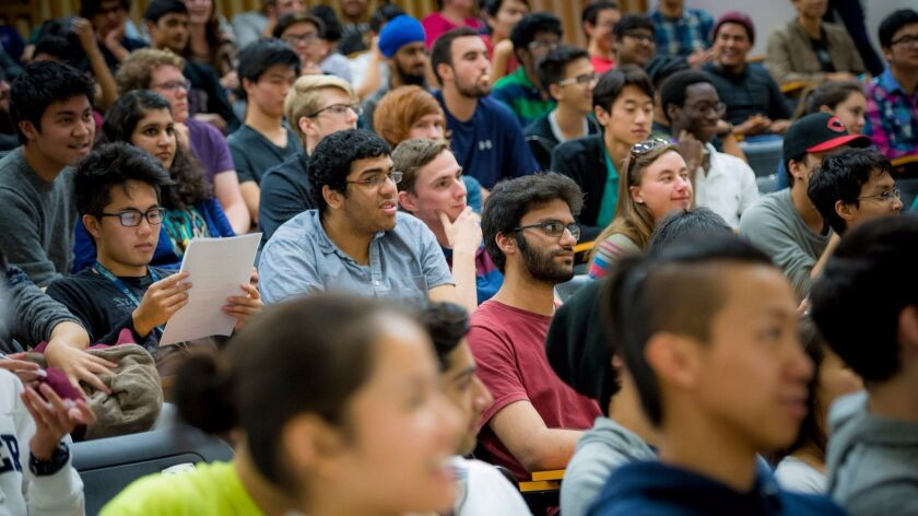 Students crowd into a lecture room at UC San Diego