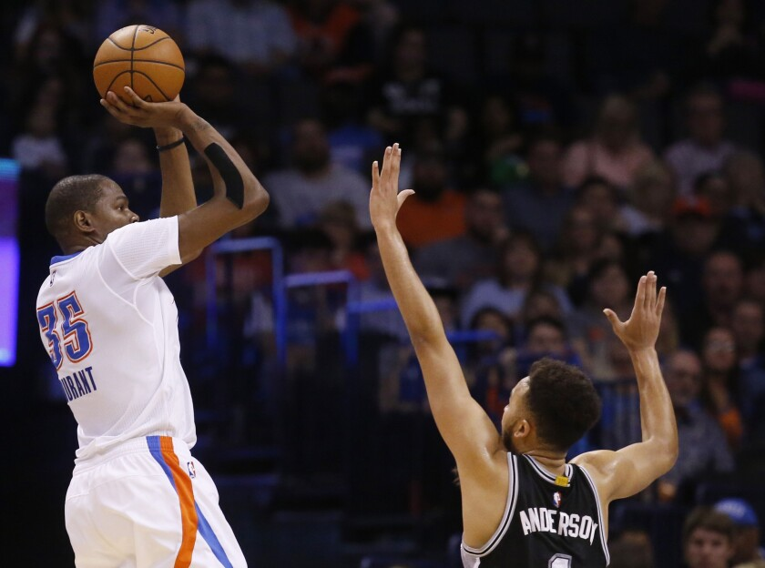 Thunder forward Kevin Durant rises up for a shot in front of Spurs forward Kyle Anderson during the third quarter of a game on March 26.