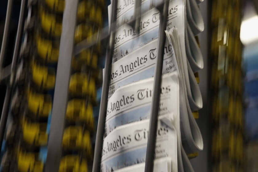 Issues of the Los Angeles Times roll off the presses