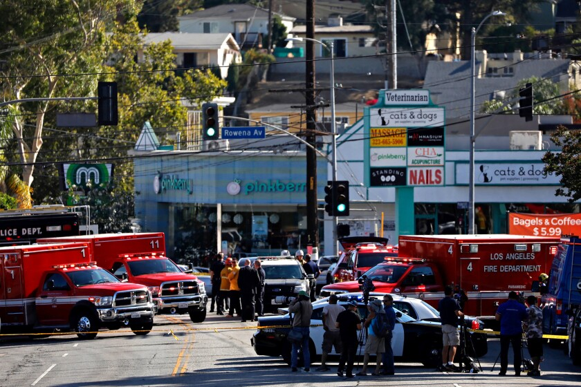 Los Angeles police on Saturday chased a suspect from Hollywood to Silver Lake, where he shot at officers outside the Trader Joe's on Hyperion Avenue.