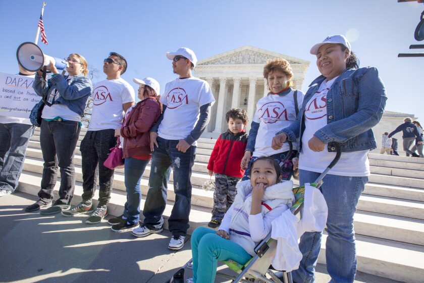Activists demonstrate at the Supreme Court earlier this year in support of President Obama's executive action to grant deportation relief to keep immigrant families together.