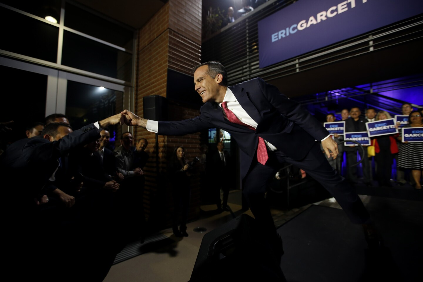 Los Angeles Mayor Eric Garcetti greets the crowd during an election night party at Laborers' International Union of North America Local 300 Hall in the Pico Union neighborhood.